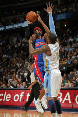 DENVER, CO - MARCH 12:  Richard Hamilton #32 of the Detroit Pistons takes a shot over Gary Forbes #0 of the Denver Nuggets at the Pepsi Center on March 12, 2011 in Denver, Colorado. NOTE TO USER: User expressly acknowledges and agrees that, by downloading