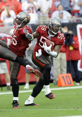 TAMPA, FL - NOVEMBER 30: Linebackers Cato June #59 and Derrick Brooks #55 of the Tampa Bay Buccaneers celebrate an interception against the New Orleans Saints at Raymond James Stadium on November 30, 2008 in Tampa, Florida.  (Photo by Al Messerschmidt/Get