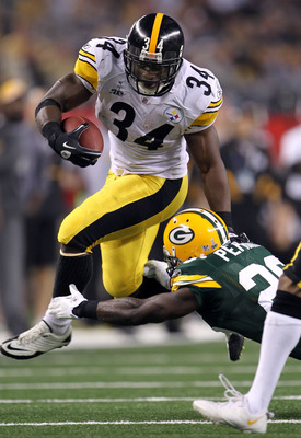 ARLINGTON, TX - FEBRUARY 06: Rashard Mendenhall #34 of the Pittsburgh Steelers avoids a tackle by Charlie Peprah #26 of the Green Bay Packers during Super Bowl XLV at Cowboys Stadium on February 6, 2011 in Arlington, Texas.  (Photo by Jamie Squire/Getty I