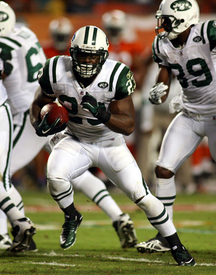 MIAMI - SEPTEMBER 26:  Running back Shonn Greene #23 of the New York Jets runs against the Miami Dolphins at Sun Life Stadium on September 26, 2010 in Miami, Florida.  (Photo by Marc Serota/Getty Images)
