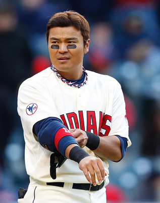 CLEVELAND - APRIL 01:  Shin-Soo Choo #17 of the Cleveland Indians removes his elbow pads inbetween innings during the Opening Day game against the Chicago White Sox on April 1, 2011 at Progressive Field in Cleveland, Ohio.  (Photo by Jared Wickerham/Getty