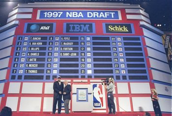 25 Jun 1997: Olivier Saint-Jean of the Sacramento Kings shakes hands with NBA Commissioner David Stern during the NBA Draft at the Charlotte Coliseum in Charlotte, North Carolina.