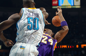 NEW ORLEANS, LA - APRIL 28:  Kobe Bryant #24 of the Los Angeles Lakers is blocked by Emeka Okafor #50 of the New Orleans Hornets in Game Six of the Western Conference Quarterfinals in the 2011 NBA Playoffs on April 28, 2011 at New Orleans Arena in New Orl