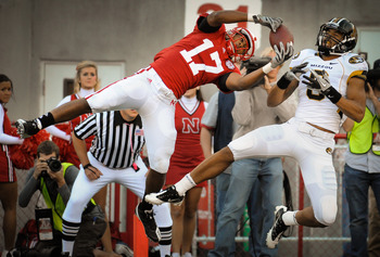 LINCOLN, NE - OCTOBER 30: Defensive back Ciante Evans #17 of the Nebraska Cornhuskers fails to pick off a pass for wide receiver Wes Kemp #8 of the Missouri Tigers during second half action of their game at Memorial Stadium on October 30, 2010 in Lincoln,