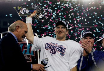 GLENDALE, AZ - FEBRUARY 03:  Quarterback Eli Manning #10 of the New York Giants holds the Vince Lombardi Trophy after defeating the New England Patriots 17-14 in Super Bowl XLII on February 3, 2008 at the University of Phoenix Stadium in Glendale, Arizona