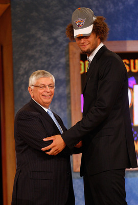 NEW YORK - JUNE 26:  NBA Commissioner David Stern shakes hands with number fifteen draft pick for the Phoenix Suns, Robin Lopez during the 2008 NBA Draft at the Wamu Theatre at Madison Square Garden June 26, 2008 in New York City. NOTE TO USER: User expre