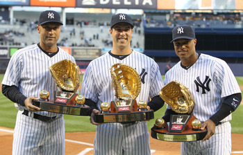NEW YORK, NY - APRIL 05: (L-R) Derek Jeter #2, Mark Teixeira #25 and Robinson Cano #24 of the New York Yankees pose with their Gold Glove Awards prior to their game against the Minnesota Twins at Yankee Stadium on April 5, 2011 in the Bronx borough of New
