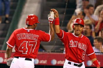 ANAHEIM, CA - AUGUST 21:  (L-R) Howie Kendrick #47 and Maicer Izturis #6 of the Los Angeles Angels of Anaheim celebrates after scoring in the second inning against the New York Yankees at Angels Stadium on August 21, 2007 in Anaheim, California.  (Photo b