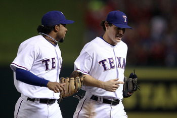 ARLINGTON, TX - OCTOBER 22:  (L-R) Elvis Andrus #1 and Ian Kinsler #5 of the Texas Rangers run off the infield towards the dugout at the end of an inning against  the New York Yankees in Game Six of the ALCS during the 2010 MLB Playoffs at Rangers Ballpar