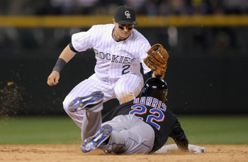 DENVER, CO - MAY 09:  Shortstop Troy Tulowitzki #2 of the Colorado Rockies tags out Willie Harris #22 of the New York Mets as he tries to steal second base in the ninth inning at Coors Field on May 9, 2011 in Denver, Colorado. The Rockies defeated the Met