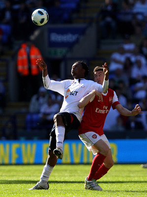 BOLTON, ENGLAND - APRIL 24:  Laurent Koscielny of Arsenal competes with Daniel Sturridge of Bolton Wanderers during the Barclays Premier League match between Bolton Wanderers and Arsenal at the Reebok Stadium on April 24, 2011 in Bolton, England.  (Photo