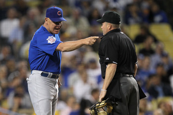 LOS ANGELES - MAY 2:  Manager Mike Quade of the Chicago Cubs argues with home plate umpire Jerry Meals in the game with the Los Angeles Dodgers on May 2, 2011 at Dodger Stadium in Los Angeles, California.  (Photo by Stephen Dunn/Getty Images)
