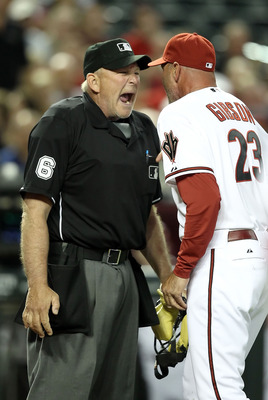 PHOENIX, AZ - APRIL 12:  Manager Kirk Gibson of the Arizona Diamondbacks argues with home plate home plate umpire Bob Davidson after being ejected from the Major League Baseball game against the St. Louis Cardinals at Chase Field on April 12, 2011 in Phoe