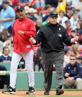 BOSTON, MA - MAY 08:  Manager Terry Francona #47 of the Boston Red Sox argued a home run call with Paul Schrieber #43 in the fourth inning against the Minnesota Twins on May 8, 2011 at Fenway Park in Boston, Massachusetts.  (Photo by Elsa/Getty Images)