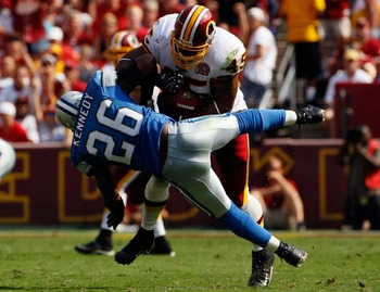 LANDOVER, MD - OCTOBER 07:  Running back Mike Sellers #45 of the Washington Redskins runs over Detroit Lions safety Kenoy Kennedy #26 in second quarter action at FedEx Field October 7, 2007 in Landover, Maryland. The Redskins defeated the Lions by a score