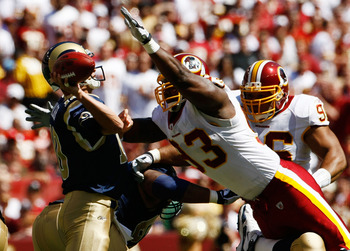 LANDOVER, MD - SEPTEMBER 20:  Mark Bulger #10 of the St. Louis Rams tries to avoid Phillip Daniels #92 of the Washington Redskins during their game on September 20, 2009 at FedEx Field in Landover, Maryland. (Photo by Win McNamee/Getty Images)