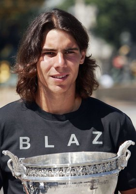 PARIS - JUNE 12:  Spanish tennis star Rafael Nadal poses with his trophy in the Place de la Concorde on June 12, 2006 in Paris, France. Nadal won the French Open final. beating Roger Federer at Roland Garros 1-6, 6-1, 6-4, 7-6.  (Photo by Francois Durand/
