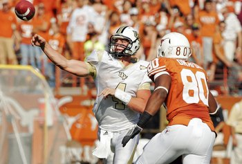AUSTIN, TX - NOVEMBER 07:  Quarterback Rob Calabrese #4 of the UCF Kights throws past defensive end Alex Okafor#80 of the Texas Longhorns on November 7, 2009 at Darrell K Royal - Texas Memorial Stadium in Austin, Texas.  Texas won 35-3.  (Photo by Brian B