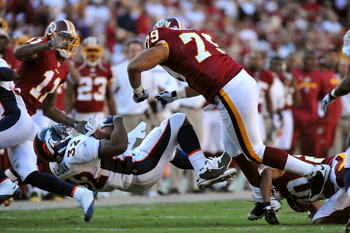 LANDOVER, MD - NOVEMBER 15:  Lorenzo Alexander #79 of the Washington Redskins flattens Lamont Jordan #32 of the Denver Broncos at FedExField on November 15, 2009 in Landover, Maryland. The Redskins defeated the Broncos 27-17. (Photo by Larry French/Getty