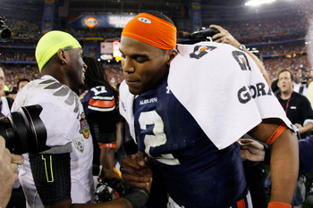 GLENDALE, AZ - JANUARY 10:  Darron Thomas #1 of the Oregon Ducks shakes hands with Cameron Newton #2 of the Auburn Tigers after the Tigers defeated the Ducks 22 to 19 in the Tostitos BCS National Championship Game at University of Phoenix Stadium on Janua
