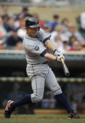 MINNEAPOLIS, MN - MAY 11: Brandon Inge #15 of the Detroit Tigers hits an RBI triple against the Minnesota Twins during in the ninth inning of their game on May 11, 2011 at Target Field in Minneapolis, Minnesota. Tigers defeated the Twins 9-7. (Photo by Ha