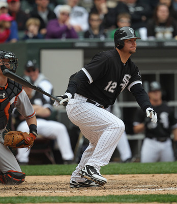 CHICAGO, IL - MAY 01: A.J. Pierzynski #12 of the Chicago White Sox hits the ball against the Baltimore Orioles at U.S. Cellular Field on May 1, 2011 in Chicago, Illinois. The Orioles defeated the White Sox 6-4. (Photo by Jonathan Daniel/Getty Images)