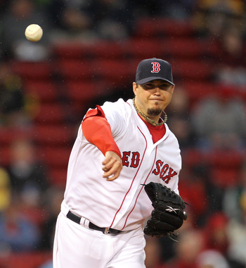 BOSTON, MA - MAY 4:  Josh Beckett #19 of the Boston Red Sox throws to first against the Los Angeles Angels of Anaheim at Fenway Park on May 4, 2011 in Boston, Massachusetts. (Photo by Jim Rogash/Getty Images)