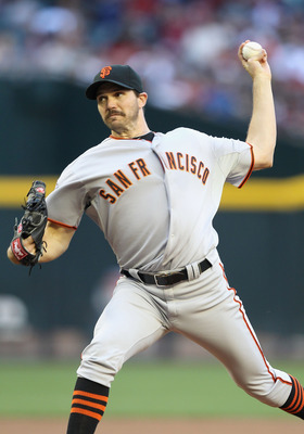 PHOENIX, AZ - APRIL 16:  Starting pitcher Barry Zito #75 of the San Francisco Giants pitches against the Arizona Diamondbacks during the Major League Baseball game at Chase Field on April 16, 2011 in Phoenix, Arizona. The Giants defeated the Diamondbacks