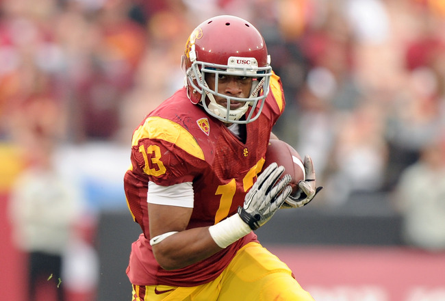 LOS ANGELES, CA - OCTOBER 16:  Robert Woods #13 of the USC Trojans carries the ball during the game against the California Golden Bears at Los Angeles Memorial Coliseum on October 16, 2010 in Los Angeles, California.  (Photo by Harry How/Getty Images)