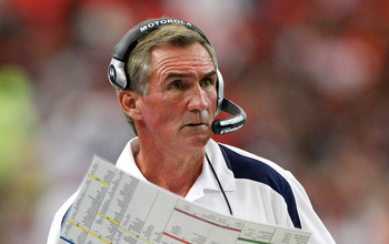 ATLANTA - NOVEMBER 16:  Head coach Mike Shanahan of the Denver Broncos looks at his playbook against the Atlanta Falcons during the game at the Georgia Dome on November 16, 2008 in Atlanta, Georgia.  (Photo by Kevin C. Cox/Getty Images)