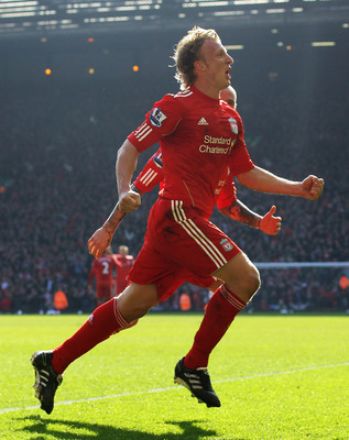 LIVERPOOL, ENGLAND - MARCH 06:  Dirk Kuyt of Liverpool celebrates scoring his team's second goal  during the Barclays Premier League match between Liverpool and Manchester United at Anfield on March 6, 2011 in Liverpool, England.  (Photo by Alex Livesey/G