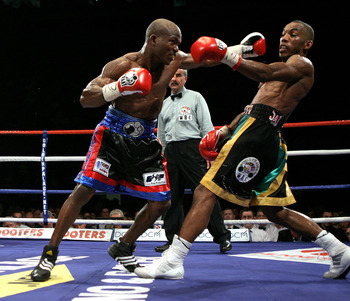 NOTTINGHAM, ENGLAND - MAY 10:  Timothy Bradley (L) misses with a left hook in his fight against Junior Witter during their WBC Light Welterweight fight on May 10, 2008 at Nottingham Ice Arena in Nottingham, England. (Photo by John Gichigi/Getty Images)