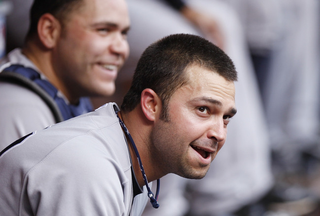 CINCINNATI, OH - JUNE 22: Nick Swisher #33 and Russell Martin #55 of the New York Yankees look on during the second game of a doubleheader against the Cincinnati Reds at Great American Ball Park on June 22, 2011 in Cincinnati, Ohio. (Photo by Joe Robbins/