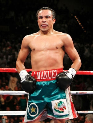 LAS VEGAS - SEPTEMBER 19:  Juan Manuel Marquez of Mexico stands up after being knocked down in the second round against Floyd Mayweather Jr. during their welterweight bout at the MGM Grand Garden Arena September 19, 2009 in Las Vegas, Nevada. (Photo by Et