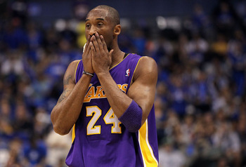 DALLAS, TX - MAY 08:  Guard Kobe Bryant #24 of the Los Angeles Lakers wipes his face during play against the Dallas Mavericks in Game Four of the Western Conference Semifinals during the 2011 NBA Playoffs on May 8, 2011 at American Airlines Center in Dall
