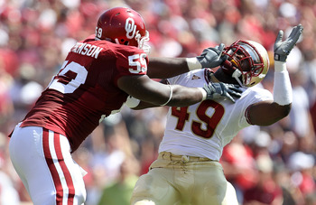 NORMAN, OK - SEPTEMBER 11:  Offensive lineman Donald Stephenson #59 of the Oklahoma Sooners grabs the facemask of Brandon Jenkins #49 of the Florida State Seminoles at Gaylord Family Oklahoma Memorial Stadium on September 11, 2010 in Norman, Oklahoma.  (P