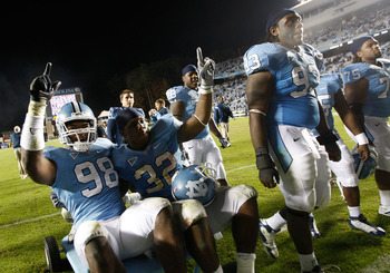 CHAPEL HILL, NC - NOVEMBER 07:  Teammates Donte Paige-Moss #98 and Ryan Houston #32 of the North Carolina Tar Heels celebrate after defeating the Duke Blue Devils 19-6 during their game at Kenan Stadium on November 7, 2009 in Chapel Hill, North Carolina.