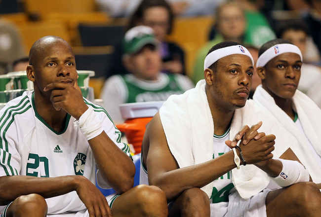 BOSTON - MAY 07:  Ray Allen #20; Paul Pierce #34, Rajon Rondo #9 and Kevin Garnett #5 of the Boston Celtics watch the closing moments of a loss to the Cleveland Cavaliers in Game Three of the Eastern Conference Semifinals during the 2010 NBA Playoffs at T