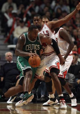 CHICAGO, IL - APRIL 07: Glen Davis #11 of the Boston Celtics moves against Kurt Thomas #40 of the Chicago Bulls at United Center on April 7, 2011 in Chicago, Illinois. The Bulls defeated the Celtics 97-81. NOTE TO USER: User expressly acknowledges and agr