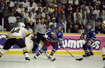 Jun 1994:  Mark Messier #11 of the New York Rangers takes control of the puck during the Stanley Cup Finals against the Vancover Canucks at the Pacific Coliseum in Vancover, Canada. Mandatory Credit: Mike Powell  /Allsport