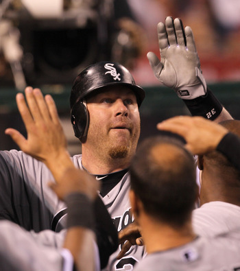 ANAHEIM, CA - MAY 11:  Adam Dunn #32 of the Chicago White Sox is greeted by teammates in the dugout after hitting a solo home run in the  thiird inning against the Los Angeles Angels of Anaheim on May 11, 2011 at Angel Stadium in Anaheim, California.   (P
