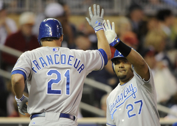 MINNEAPOLIS, MN - APRIL 12: Jeff Francoeur #21 and Brayan Pena #27 of the Kansas City Royals celebrate Francoeur scoring against the Minnesota Twins during the fourth inning of their game on April 12, 2011 at Target Field in Minneapolis, Minnesota. (Photo