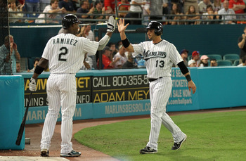 MIAMI GARDENS, FL - MAY 10:  Omar Infante #13 of the Florida Marlins is congratulated By Hanley Ramirez #2 after scoring the go ahead run during a game against the Philadelphia Phillies at Sun Life Stadium on May 10, 2011 in Miami Gardens, Florida.  (Phot
