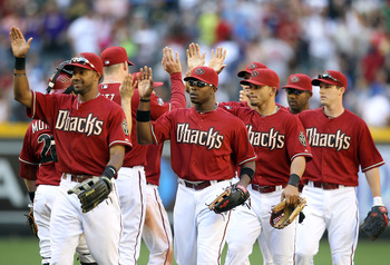 PHOENIX, AZ - MAY 01:  Justin Upton #10 of the Arizona Diamondbacks high fives teammates after defeating the Chicago Cubs in the Major League Baseball game at Chase Field on May 1, 2011 in Phoenix, Arizona.  The Diamondbacks defeated the Cubs 4-3. (Photo