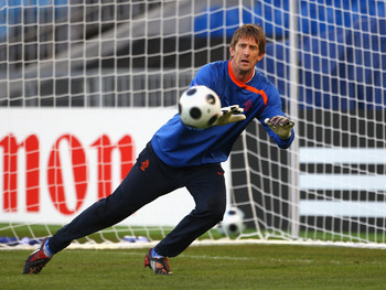 BASEL, SWITZERLAND - JUNE 20: Edwin van der Sar of The Netherlands makes a save during training ahead of the Euro 2008 Quarter Final at St Jacob Park on June 20, 2008 in Basel, Switzerland.  (Photo by Laurence Griffiths/Getty Images)