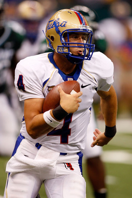 NEW ORLEANS - SEPTEMBER 04:  Quarterback G.J. Kinne #4 of the Tulsa Golden Hurricanes scrambles with the football against the Tulane Green Wave at the Louisiana Superdome on September 4, 2009 in New Orleans, Louisiana.   The Hurricanes defeated the Green