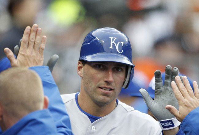 DETROIT - APRIL 09: Jeff Francoeur #21 of the Kansas City Royals is congratulated by his teammates after scoring in the second inning during the game against the Detroit Tigers at Comerica Park on April 9, 2011 in Detroit, Michigan.  (Photo by Leon Halip/