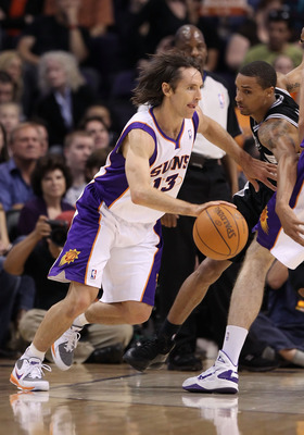 PHOENIX, AZ - APRIL 13:  Steve Nash #13 of the Phoenix Suns drives the ball during the NBA game against the San Antonio Spurs at US Airways Center on April 13, 2011 in Phoenix, Arizona.  NOTE TO USER: User expressly acknowledges and agrees that, by downlo