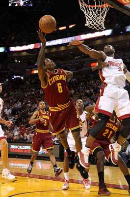 MIAMI, FL - JANUARY 31:  Manny Harris #6 of the  Cleveland Cavaliers shoots over Dwyane Wade #3 of the Miami Heat during a game against at American Airlines Arena on January 31, 2011 in Miami, Florida. NOTE TO USER: User expressly acknowledges and agrees
