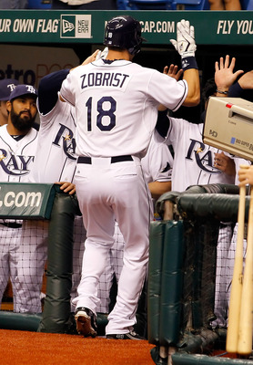 ST PETERSBURG, FL - APRIL 18:  Outfielder Ben Zobrist #18 of the Tampa Bay Rays is congratulated after his home run against the Chicago White Sox during the game at Tropicana Field on April 18, 2011 in St. Petersburg, Florida.  (Photo by J. Meric/Getty Im